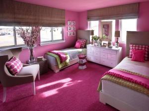 Dormitorio con paredes pintadas rosa